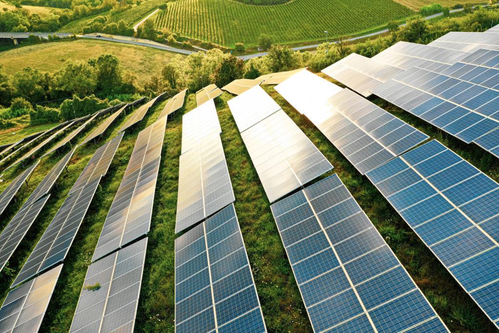 solar panels fields on green hills